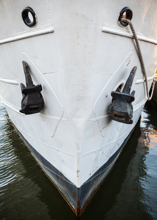 ship bow: Close up photo of an old ship bow with anchors Stock Photo