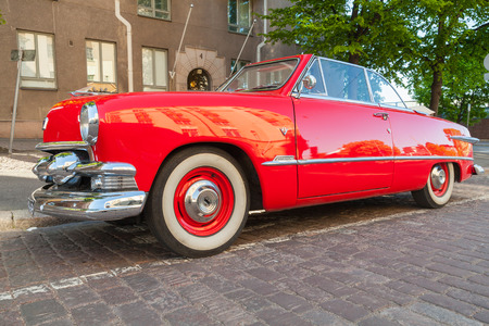 custom car: Helsinki, Finland - June 13, 2015: Old red Ford Custom Deluxe Tudor car is parked on the roadside. 1951 year modification with convertible roof