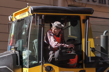 steam roller: Saint-Petersburg, Russia - May 30, 2015: man at work, industrial steam roller driver in the cabin