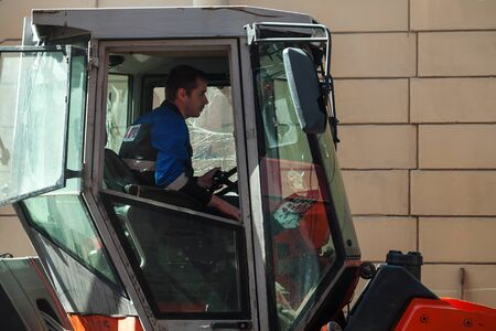 steam roller: Saint-Petersburg, Russia - May 30, 2015: men at work, steam roller driver in the cabin
