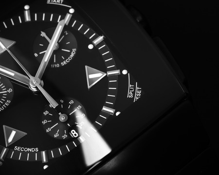 selective focus: Luxury mens Chronograph Watch made of black high-tech ceramics with sapphire glass. Close-up studio photo with selective focus