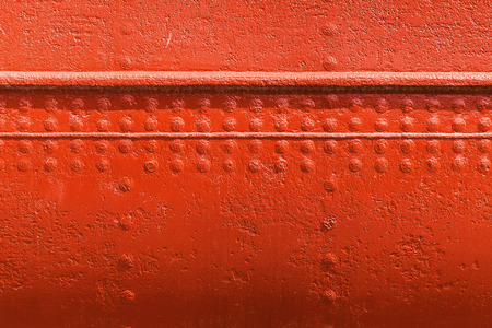 red metal: Old ships hull texture, red metal wall texture with seams and rivets Stock Photo