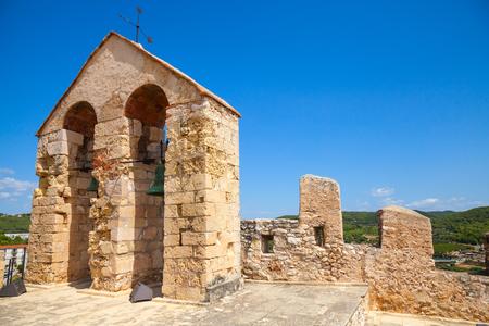 arcos de piedra: Castillo de piedra medieval en la ciudad de Calafell, Espa�a. Las campanas que cuelgan en arcos Editorial