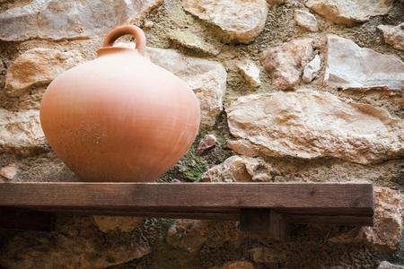 spherical: Spherical crock stands on old wooden shelf