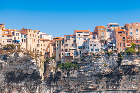Old living houses on the cliff. Bonifacio, Corsica island, France Standard-Bild