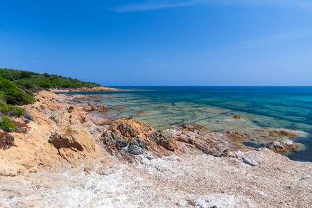 Coastal landscape with rocky wild beach, Corsica, France. Plage De Capo Di Feno
