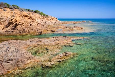 plage: Coastal landscape with rocky wild beach and blue lagoon, Corsica island, France. Plage De Capo Di Feno