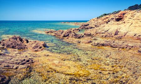 Coastal landscape with empty rocky wild beach, Corsica island, France. Plage De Capo Di Feno
