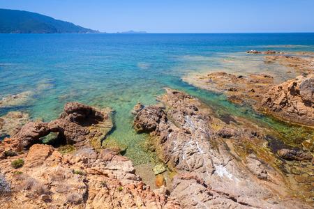 Coastal landscape with rocks and sea water, Corsica island, France. Plage De Capo Di Feno