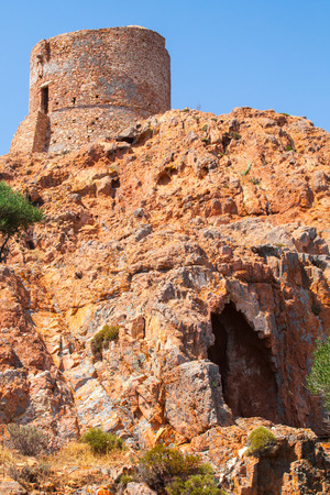 genoese: Ancient Genoese tower on Capo Rosso, Corsica island, France. Vertical photo
