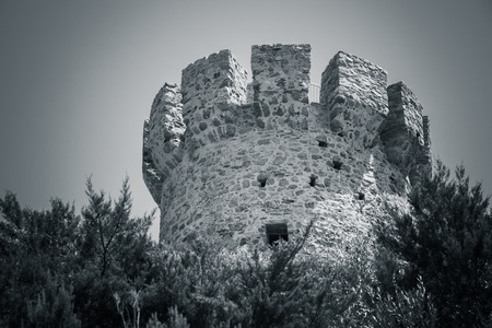 genoese: Campanella tower, old Genoese tower on Corsica island, France. Monochrome toned photo Stock Photo
