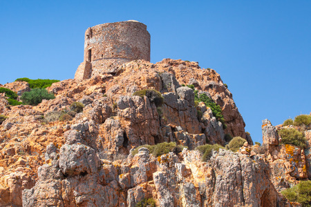 genoese: Ancient Genoese tower on Capo Rosso, Corsica island, France Stock Photo