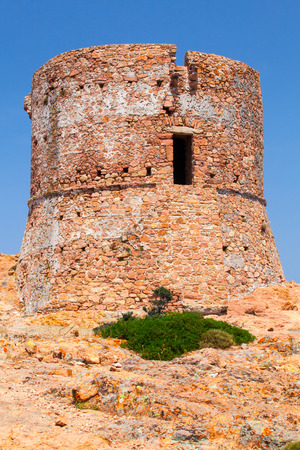 genoese: Ancient Genoese tower on Capo Rosso cliff, Corsica, France