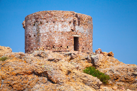 genoese: Old Genoese tower on Capo Rosso cliff, Corsica island, France. Selective focus on a foreground Stock Photo
