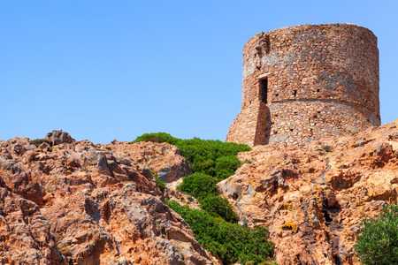 genoese: Ancient Genoese tower on Capo Rosso cliff, Corsica island, France
