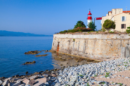 citadel: Ajaccio, citadel with white lighthouse tower, Corsica island, France Stock Photo