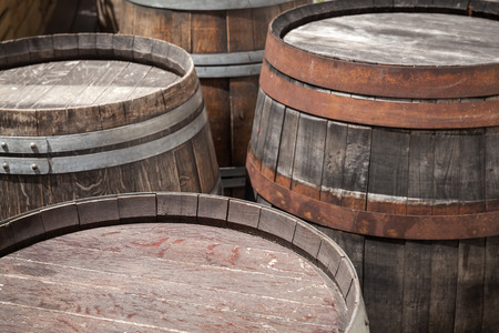 fermenting: Group of old wooden barrels, selective focus on a foreground