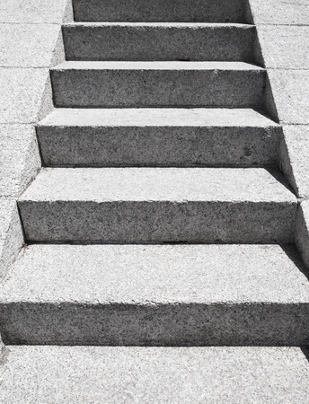 concrete steps: Stairs made of gray granite stone goes up, perspective view