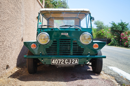 sheppard: Ajaccio, France - July 7, 2015:  Austin Mini Moke 1967, vehicle based on the Mini designed for the British Motor Corporation BMC by Sir Alec Issigonis and John Sheppard. Close-up front view