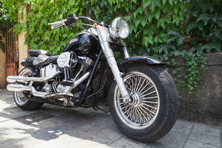 harley davidson motorcycle: Ajaccio, France - July 6, 2015:  Black Harley Davidson motorcycle with chromed details stands parked