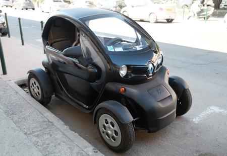 green and black: Ajaccio, France - June 30, 2015: Black Renault Z.E. all-electric car on the roadside in Ajaccio, Corsica island