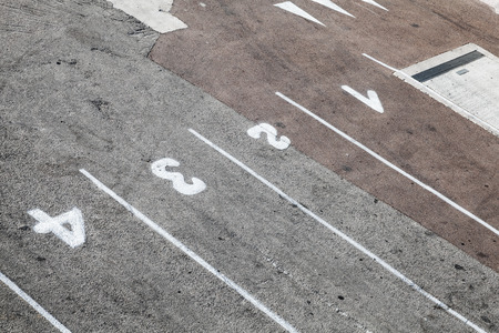 dividing lines: Ferry terminal loading port area, road marking with lane numbers and dividing lines on gray asphalt
