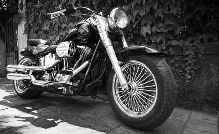 Ajaccio, France - July 6, 2015:  Black Harley Davidson motorcycle with chromed details stands parked in a town