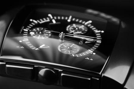 cronógrafo: San Petersburgo, Rusia - 18 de junio 2015: Rado Sintra Chrono, reloj cronógrafo para hombre hecha de cerámica de alta tecnología con cristal de zafiro sobre fondo negro. Enfoque selectivo Editorial