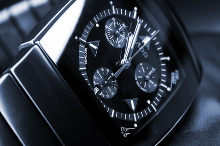 tonal: Saint-Petersburg, Russia - June 18, 2015: Rado Sintra Chrono, Mens Chronograph Watch made of black high-tech ceramics with sapphire glass. Closeup studio photo with artistic blue tonal filter