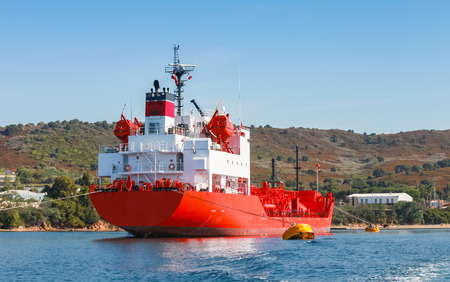 superstructure: Red Liquefied Petroleum Gas LPG tanker with white superstructure stands moored in Port of Ajaccio, Corsica, France