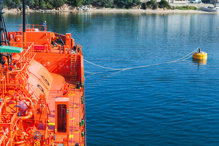 liquefied: Red Liquefied Petroleum Gas tanker does mooring operations in Port of Ajaccio, Corsica, France