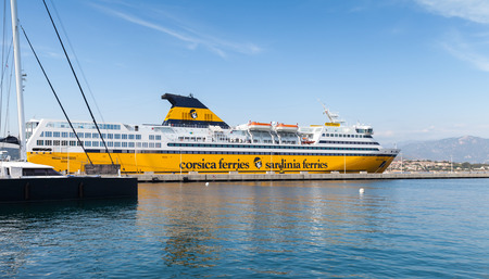 ferries: Ajaccio, France - June 29, 2015: The Mega Express ferry, big yellow passenger ship operated by Corsica Ferries Sardinia Ferries shipping company moored in Ajaccio port