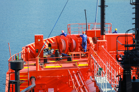 liquefied: Ajaccio, France - June 30, 2015: Bow fragment with equipment and sailors of Red Liquefied Petroleum Gas tanker Editorial