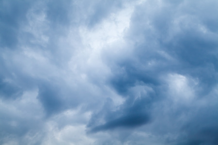 Blue stormy clouds, natural sky background photo texture