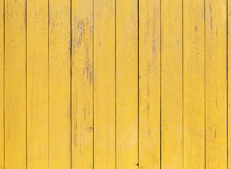 wood fences: Old yellow wooden wall with cracked paint layer, detailed background photo texture Stock Photo