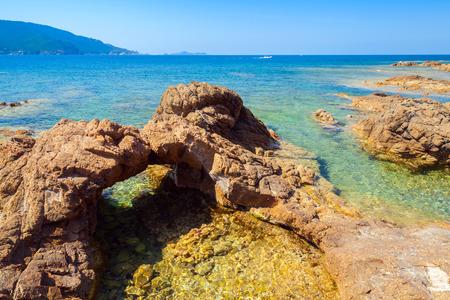 Natural stone grotto on the Mediterranean coast, South Corsica, France. Plage De Capo Di Feno