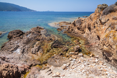 Coastal landscape with rocks and sea water, South Corsica, France. Plage De Capo Di Feno