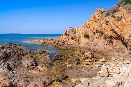 Coastal landscape with empty rocky wild beach, South region of Corsica island, France. Plage De Capo Di Feno