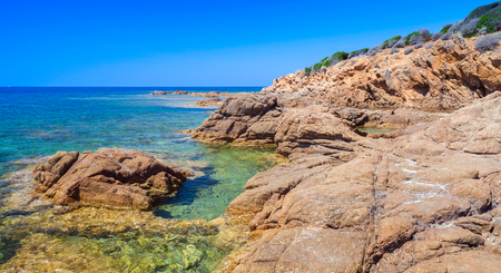 Coastal landscape of Plage De Capo Di Feno. Empty rocky wild beach, South Corsica, France