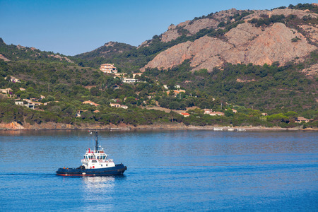 superstructure: Small tug boat with white superstructure underway on Porto-Vecchio bay, Corsica island, France