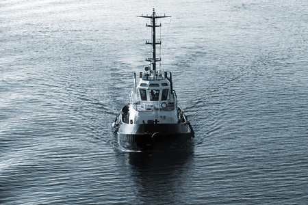 tonal: Tug boat underway, front view, dark blue tonal correction filter, retro style