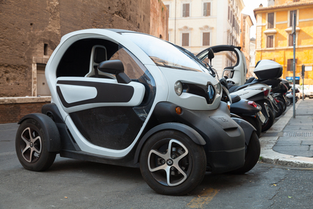 ze: Rome, Italy - August 8, 2015: Renault Z.E. all-electric car stands parked on the roadside in Roma Editorial