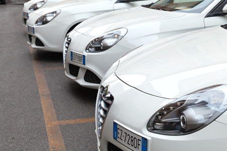 romeo: Rome, Italy - August 7, 2015: White Alfa Romeo Giulietta Type 940 cars stands parked in a row