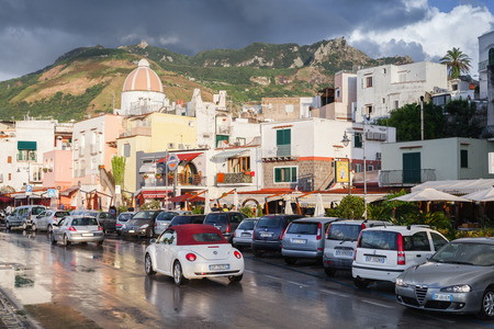 italian landscape: Forio, Italy - August 16, 2015: Wet street after the rain with cars, Forio, Ischia Editorial