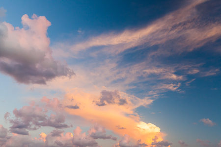 colorful cloudscape: Dramatic colorful cloudscape, summer evening sky background texture with different types of clouds in the sunlight Stock Photo