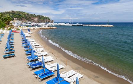commune: Empty sandy beach of  Lacco Ameno commune, Ischia island, Italy Stock Photo