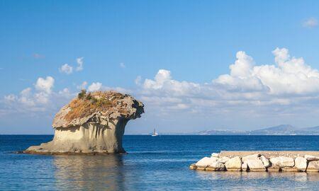 il: Il Fungo, the famous rock in shape of mushroom in Lacco Ameno bay, Ischia island, Italy