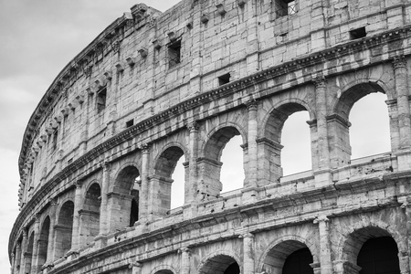 black history: Exterior of the Colosseum or Coliseum, also known as the Flavian Amphitheatre. Black and white photo