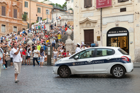 emergency stair: Rome, Italy - August 07, 2015: White Police car stands on the street near Spanish stairs in historical center of Rome city Editorial
