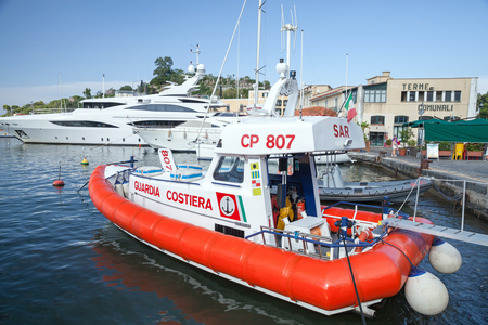 coast guard: Ischia, Italy - August 15, 2015: White and red Italian Coast guard boat stands in Ischia port